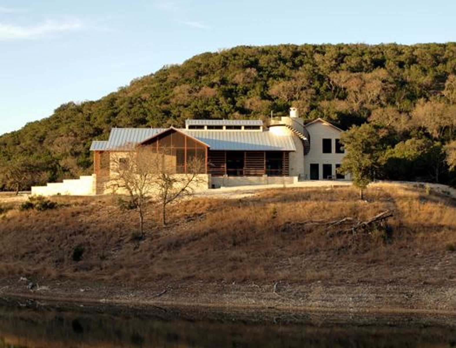 Texas hill country architect echo valley ranch designer for Hill country architecture